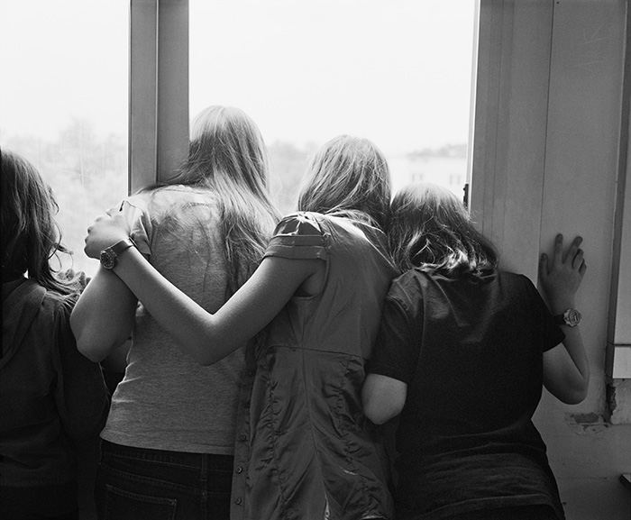 Four Year 10 pupils at a window, inner-city school Jean-Jaurès, Montreuil, 2010